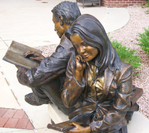 Bronze sculpture titled Compassion by sculptor Greg Todd