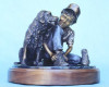 First Loves, a table top sculpture of a boy and his dog by Greg Todd