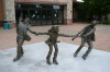 Wild Ice, figurative bronze by Colorado sculptor Greg Todd. Kids playing crack the whip