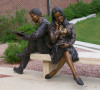 Compassion, figurative bronze sculpture by Greg Todd, features a life-sized male and female student