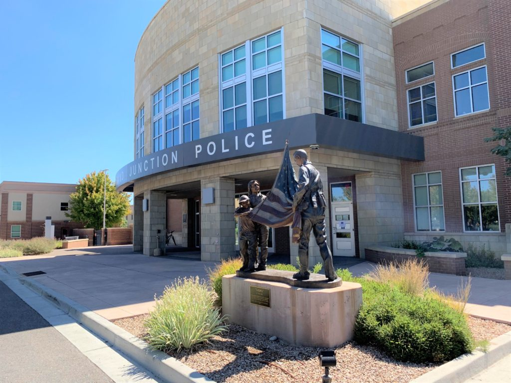 Legacy bronze sculpture by Colorado artist Greg Todd in front of Police Station